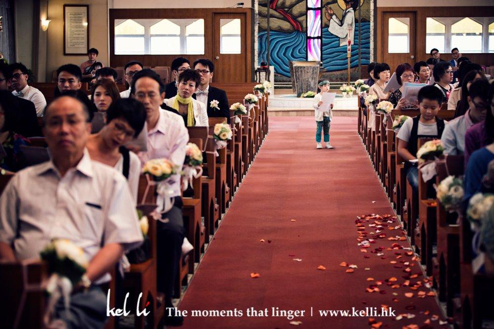 A kid in the church aisle
