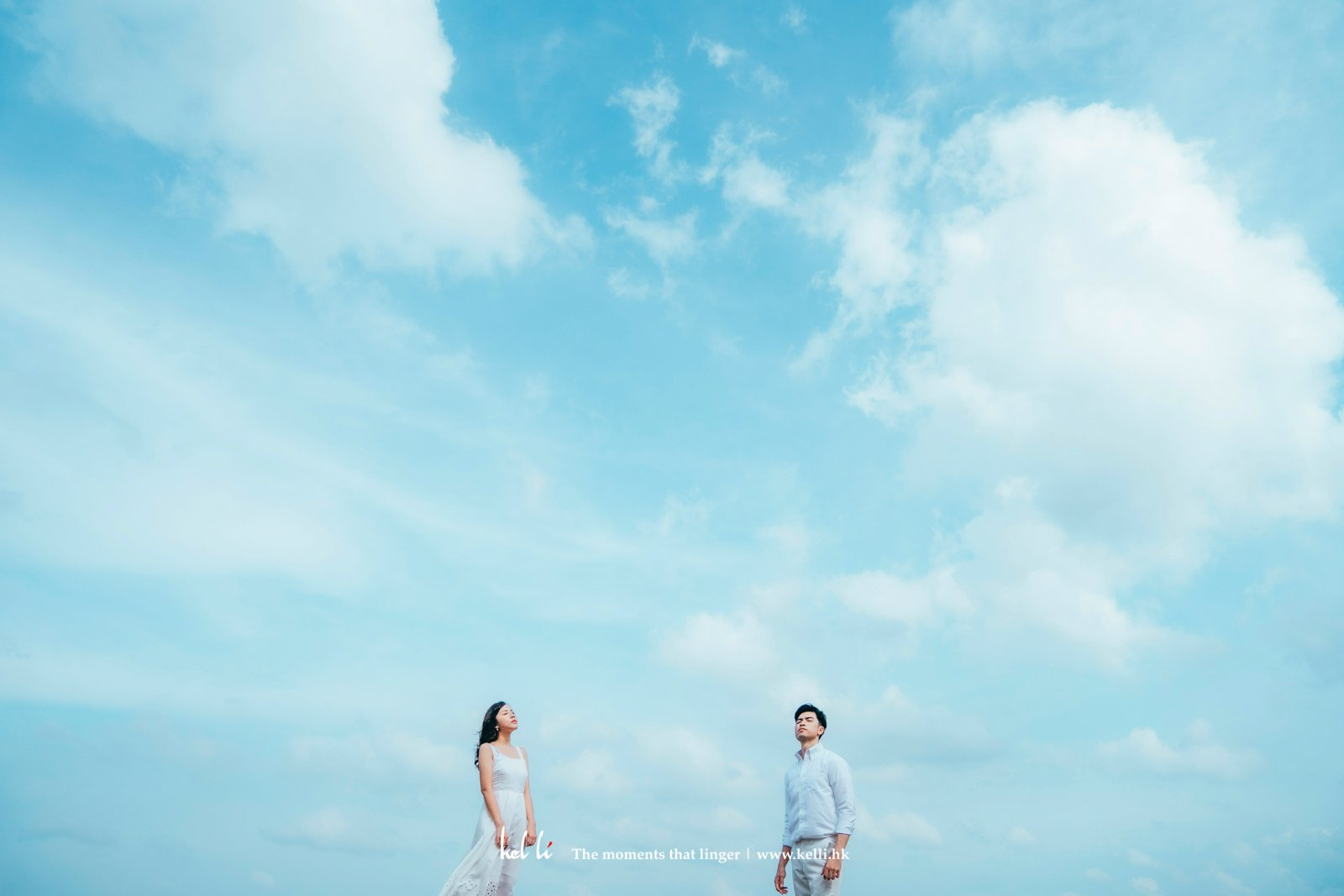 夏天的藍天份外多層次,沒有了婚紗,卻也帶著一片清新